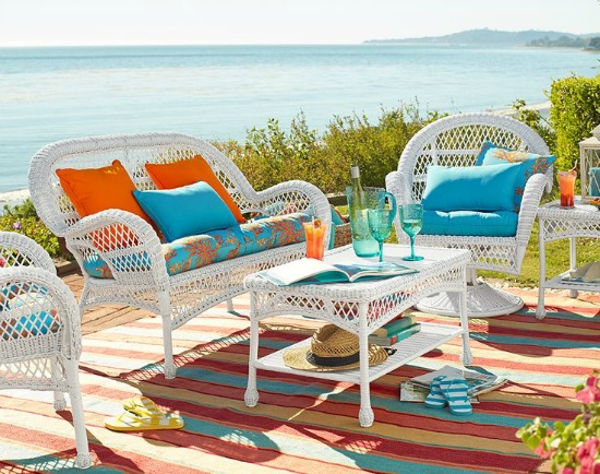 White outdoors sitting with orange and turquoise pillows