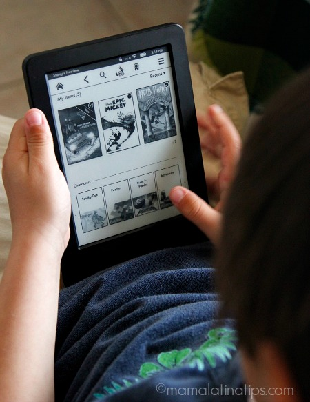 Boy reading on the Kindle