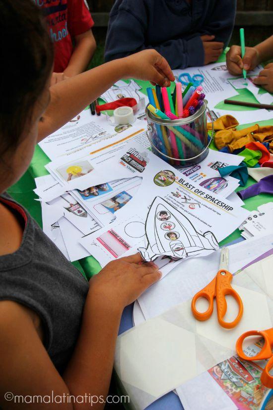 Kids making paper rockets