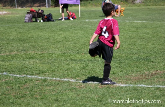 Kid stretching before soccer game