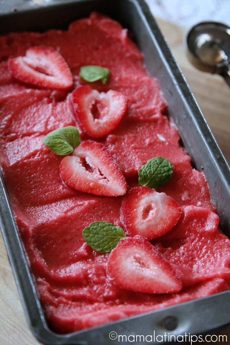 Strawberry ice cream with fresh strawberries and mint on top