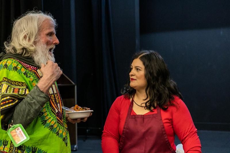 Silvia Martinez from mamalatinatips.com talking to a senior from the Long Beach Senior Arts Colony